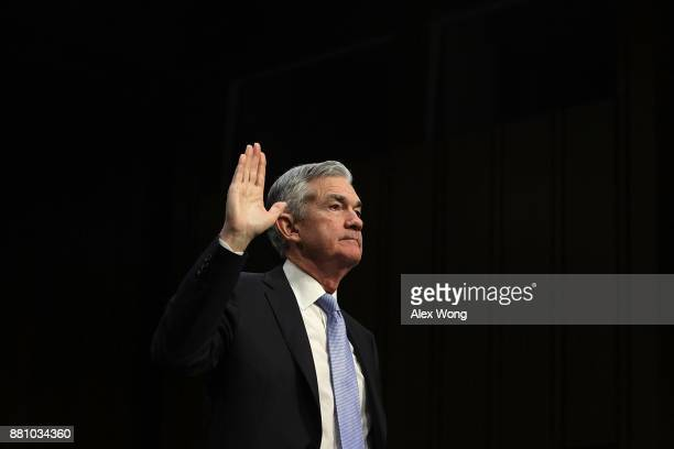 Chairman of the Federal Reserve nominee Jerome Powell is sworn in during his confirmation hearing before the Senate Banking Housing and Urban Affairs...