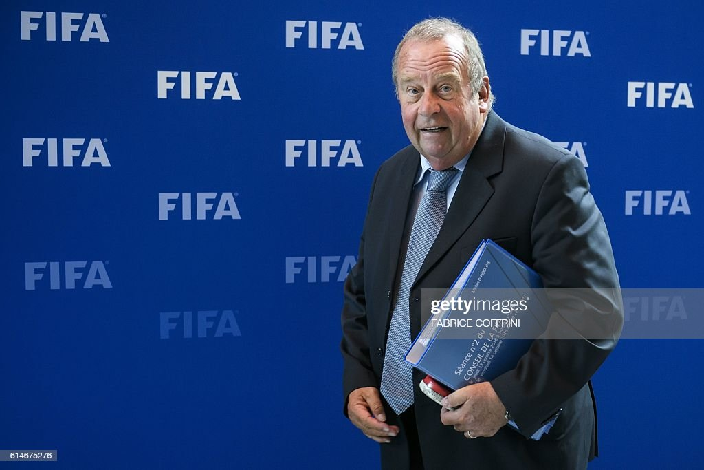 Chairman of the FIFA medical committee Michel D'Hooghe of Belgium smiles posing after a meeting of the FIFA Council on October 14, 2016 at the world football's governing body headquarters in Zurich. FIFA executives will make a final decision on World Cup reform in January after weighing up three proposals on October 13, as president Gianni Infantino pushes plans to grow the lucrative tournament. / AFP / FABRICE