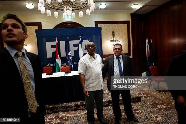 Chairman of the FIFA Monitoring Committee IsraelPalestine Tokyo Sexwale and Israel's Football Association president Ofer Eini chat at the end of a...