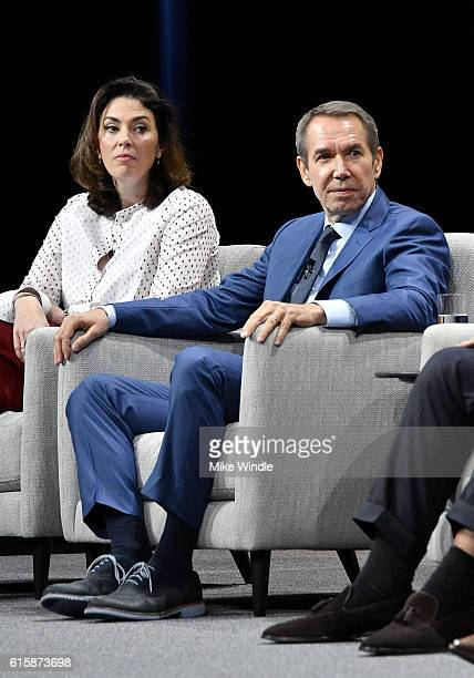 Chairman of the fine arts division at Sotheby's Amy Cappellazzo and artist Jeff Koons speak onstage during 'Pixels at an Exhibition The New Art...