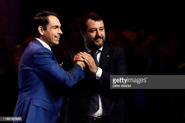 Chairman of the Flemish far-right party Vlaams Belang, Tom Van Grieken , greets leader of Italy's far-right League party Matteo Salvini during a...