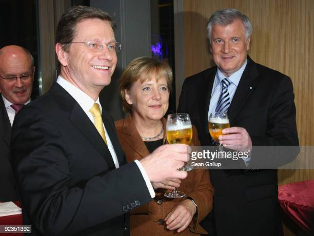 Chairman of the German Free Democrats Guido Westerwelle German Chancellor and Chairwoman of the German Christian Democrats Angela Merkel and Chairman...