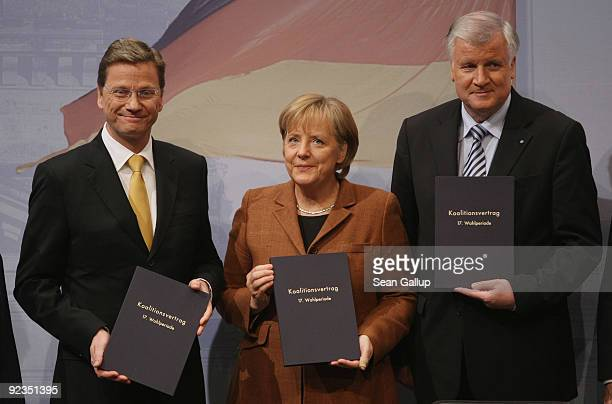 Chairman of the German Free Democrats Guido Westerwelle, German Chancellor and Chairwoman of the German Christian Democrats Angela Merkel and...