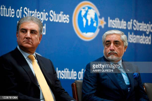 Chairman of the High Council for National Reconciliation of Afghanistan Abdullah Abdullah and Pakistan's Foreign Minister Shah Mahmood Qureshi attend...