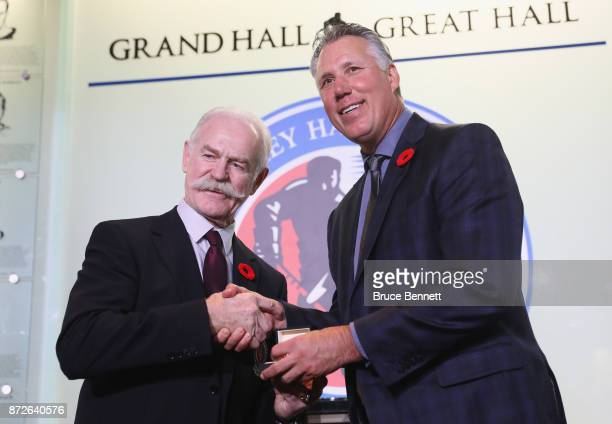 Chairman of the Hockey Hall of Fame Lanny McDonald presents Dave Andreychuk with the Hall ring during a media opportunity at the Hockey Hall Of Fame...