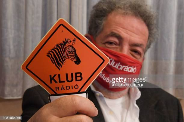 Chairman of the independent Hungarian radio station, the 'Klubradio' Andras Arato shows a Klubradio logo in their headquarters in Budapest on...