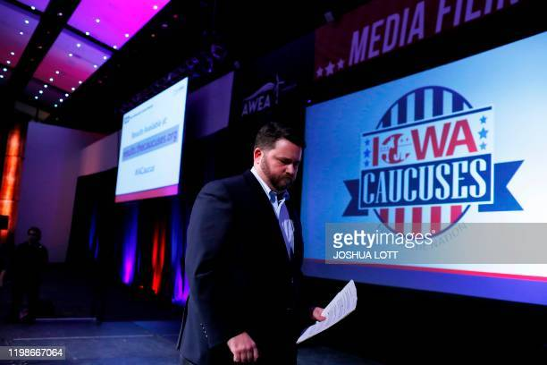Chairman of the Iowa Democratic Party Troy Price exits the stage after speaking about the technical issues that delayed the Iowa Democratic caucuses...