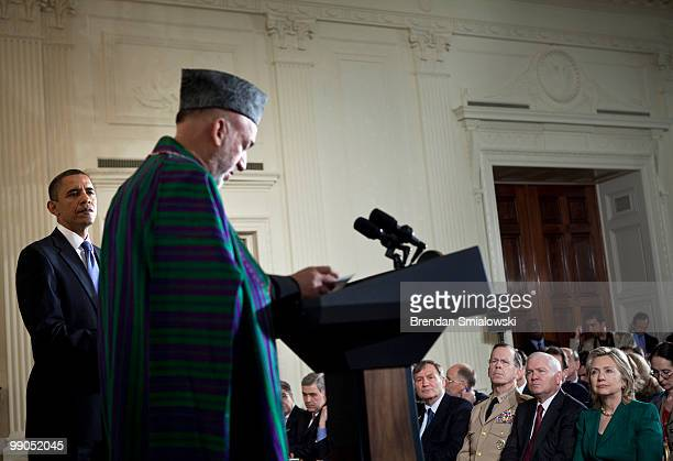 Chairman of the Joint Chiefs Admiral Mike Mullen Secretary of Defense Robert M Gates and Secretary of State Hillary Rodham Clinton and others listen...