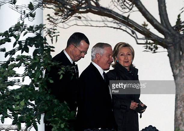 Chairman of the Joint Chiefs of Staff Admiral Michael Mullen Defense Secretary Robert Gates and Secretary of State Hillary Clinton walk from the Oval...