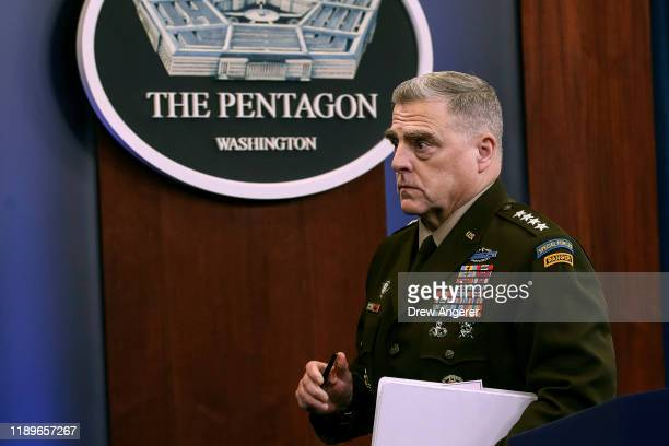 Chairman of the Joint Chiefs of Staff Army Gen Mark Milley exits after an end of year press conference at the Pentagon on December 20 2019 in...