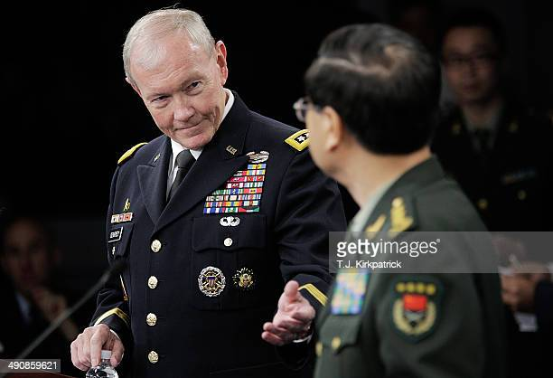 Chairman of the Joint Chiefs of Staff Army Gen Martin Dempsey and People's Liberation Army of China Chief of the General Staff Gen Fang Fenghui hold...