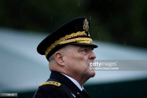 Chairman of the Joint Chiefs of Staff Army General Mark Milley looks on during a welcome ceremony at Fort Myer September 30 in Summerall Field Joint...