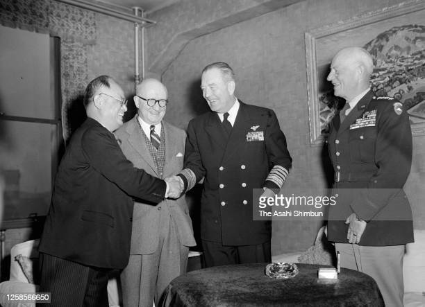 Chairman of the Joint Chiefs of Staff Arthur W. Radford and Commander In Chief of the Far East Command John Hull and U.S. Ambassador to Japan John...