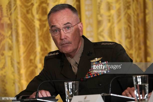 S Chairman of the Joint Chiefs of Staff Gen Joseph Dunford listens during a meeting of the National Space Council at the East Room of the White House...