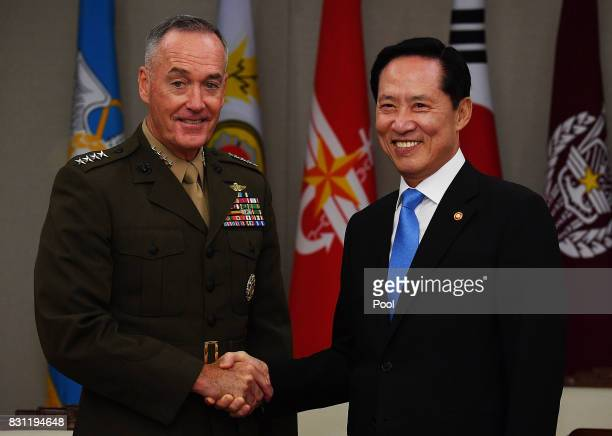 US Chairman of the Joint Chiefs of Staff Gen Joseph Dunford shakes hands with South Korean Defence Minister Song Youngmoo during their meeting at the...