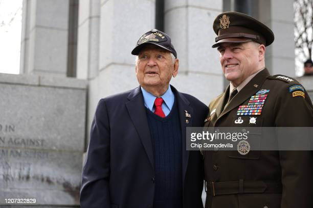 Chairman of the Joint Chiefs of Staff Gen Mark Milley and Navy veteran Ira Rigger who participated in the Battle of Iwo Jima pose for photographs...