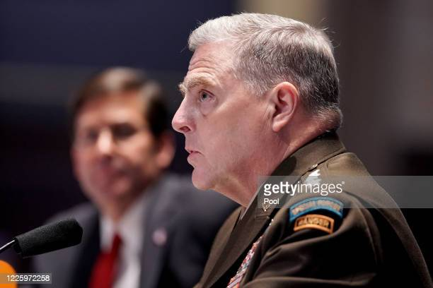 Chairman of the Joint Chiefs of Staff Gen. Mark Milley and Secretary of Defense Mark Esper testify during a House Armed Services Committee hearing on...