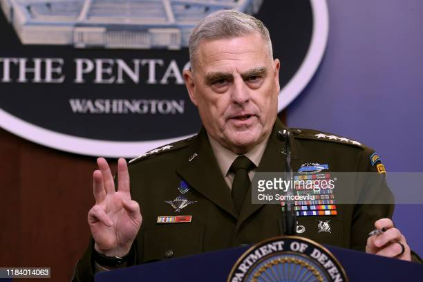 S Chairman of the Joint Chiefs of Staff Gen Mark Milley answers reporters' questions during a news conference at the Pentagon the day after it was...