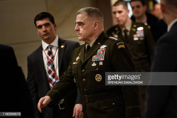Chairman of the Joint Chiefs of Staff Gen Mark Milley arrives on Capitol Hill in Washington DC on January 8 for a closed briefing on the operation...
