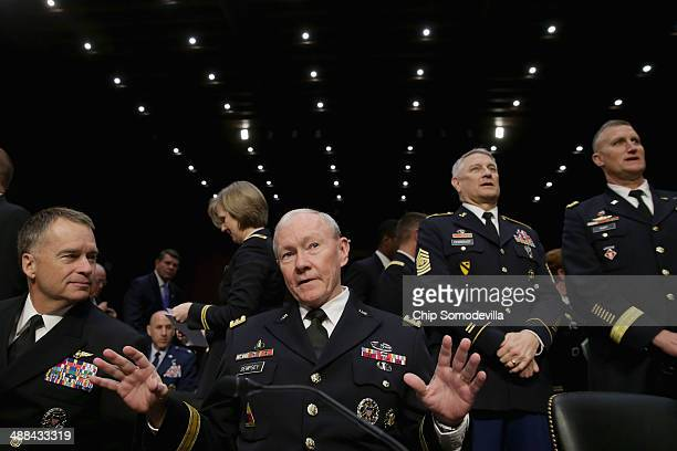 Chairman of the Joint Chiefs of Staff Gen Martin Dempsey and Vice Chairman of the Joint Chiefs of Staff Adm James Winnefeld talk before testifying to...