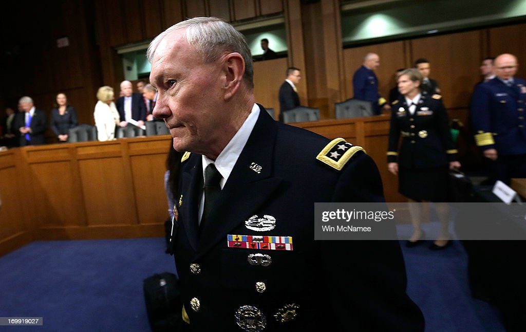Chairman of the Joint Chiefs of Staff Gen. Martin Dempsey arrives for testiomony with U.S. military leaders before the Senate Armed Services Committee on pending legislation regarding sexual assaults in the military June 4, 2013 in Washington, DC. A recent survey of active duty personnel by the Pentagon revealed that 6.1 percent of women and 1.2 percent of men reported receiving Òunwanted sexual contactÓ in the past year.