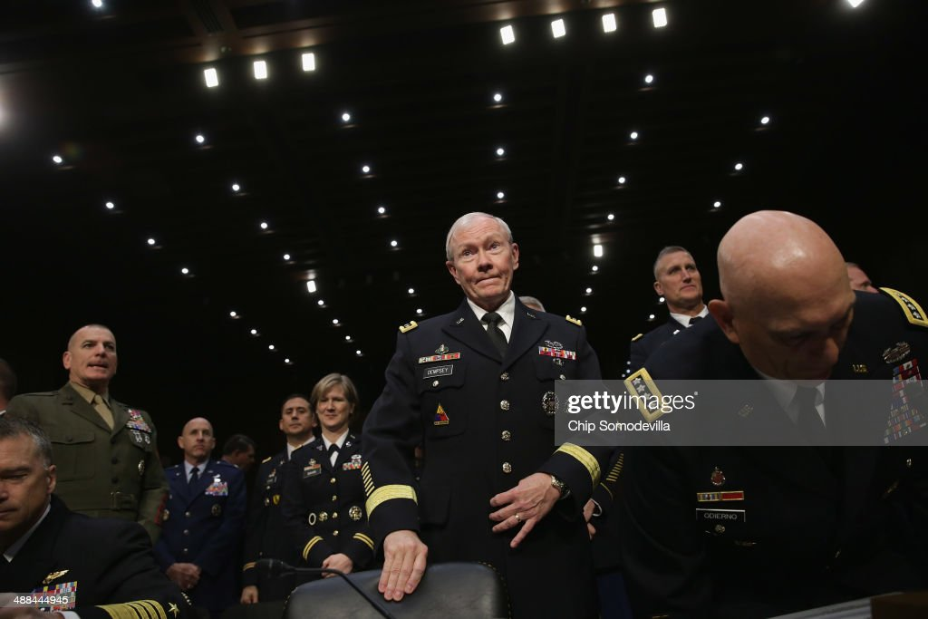 Chairman of the Joint Chiefs of Staff Gen. Martin Dempsey (C) prepares to testify before the Senate Armed Services Committee with other members of the U.S. military Joint Chiefs of Staff on Capitol Hill May 6, 2014 in Washington, DC. Joined by senior enlisted officers, the Joint Chiefs testified about proposals relating to military compensation.
