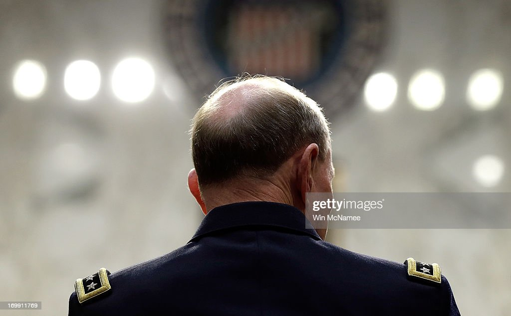 Chairman of the Joint Chiefs of Staff Gen. Martin Dempsey testifies with U.S. military leaders before the Senate Armed Services Committee on pending legislation regarding sexual assaults in the military June 4, 2013 in Washington, DC. A recent survey of active duty personnel by the Pentagon revealed that 6.1 percent of women and 1.2 percent of men reported receiving Òunwanted sexual contactÓ in the past year.