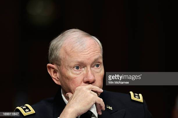 Chairman of the Joint Chiefs of Staff Gen Martin Dempsey testifies with US military leaders before the Senate Armed Services Committee on pending...