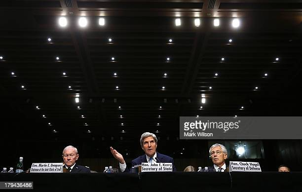 US Chairman of the Joint Chiefs of Staff Gen Martin Dempsey US Secretary of State John Kerry and US Defense Secretary Chuck Hagel testify before the...