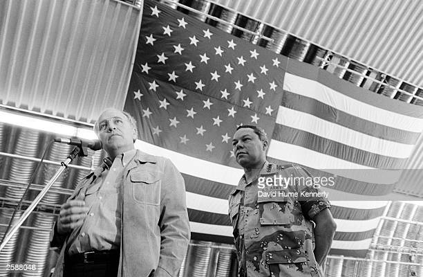 Chairman of the Joint Chiefs of Staff General Colin Powell and Secretary of Defense Dick Cheney address US military personnel in a hangar at a secret...
