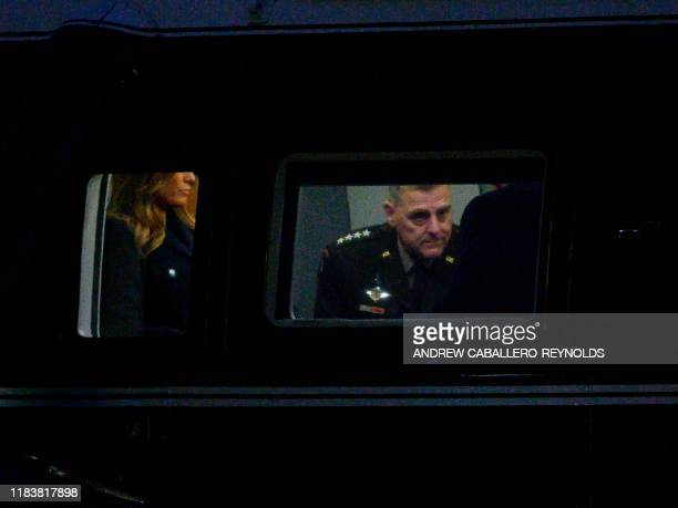 Chairman of the Joint Chiefs of Staff General Mark Milley joins US President Donald Trump and First Lady Melania Trump on Marine One as they depart...