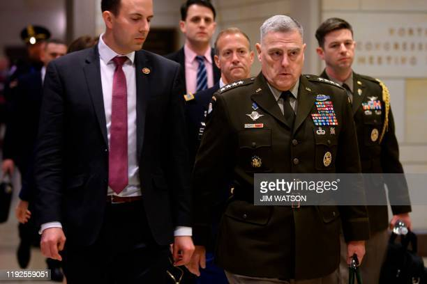 Chairman of the Joint Chiefs of Staff General Mark Milley leaves the Congressional Auditorium on Capitol Hill in Washington DC on January 8 after a...