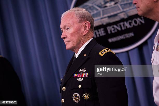 US Chairman of the Joint Chiefs of Staff General Martin Dempsey looks on as President Barack Obama delivers remarks after meeting with members of his...