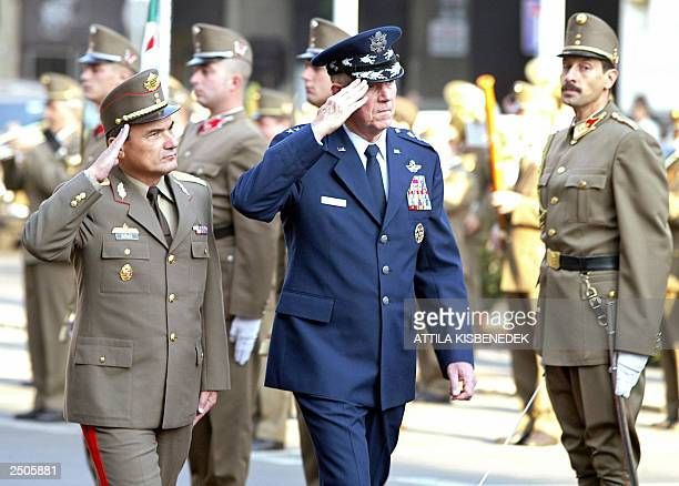 Chairman of the Joint Chiefs of Staff, General Richard B. Myers inspects an honour guard with commander-in-chief of the Hungarian Forces, General...