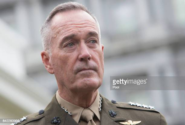 Chairman of the Joint Chiefs of Staff Joseph Dunford listens to a statement by US Secretary of Defense James Mattis at the White House on a possible...