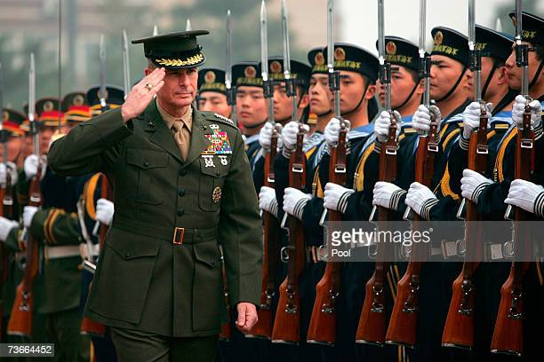 S Chairman of the Joint Chiefs of Staff Marine Gen Peter Pace salutes a welcome ceremony at the Defense Ministry in March 22 2007 Beijing China The...