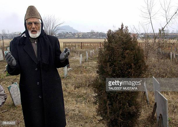 Chairman of the Kashmiri All Parties Hurriyat Conference Syed Ali Geelani gestures as he pays respect to Islamic martyrs at The Martyrs Graveyard in...