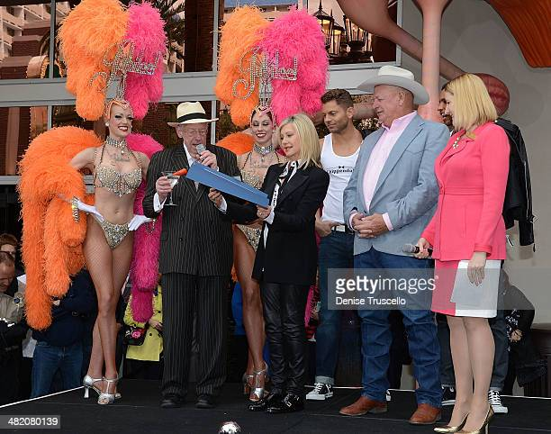 Chairman of the Las Vegas Host Committee Oscar Goodman singer Olivia NewtonJohn Clark County Commissioner Tom Collins chairman of the Las Vegas...