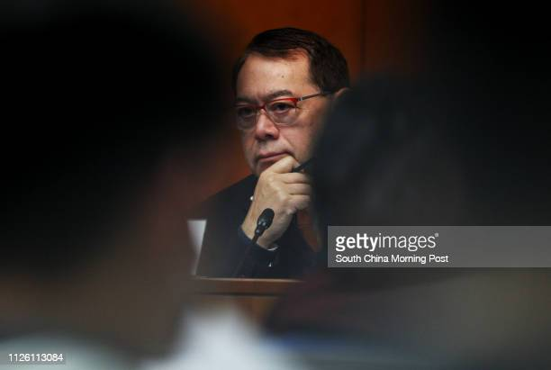 Chairman of the Legislative Council Public Accounts Committee Abraham Shek Laihim tables the PAC Report No 61 at the Legislative Council Tamar 12FEB14