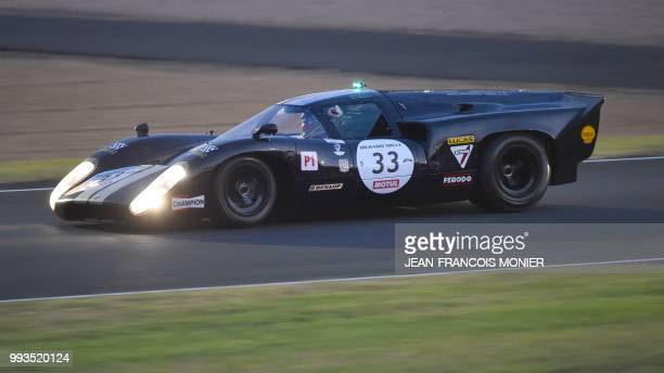 Chairman of the managing board of French carmaker PSA Peugeot Citroen Carlos Tavares in his a 1966s Lola T70 MKIII B a race for vehicles from 1923 to...