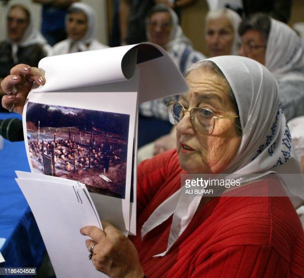 Chairman of the Mothers of Plaza de Mayo organization Hebe de Bonafini shows 15 January 2004 during a press conference in Buenos Aires a picture of a...