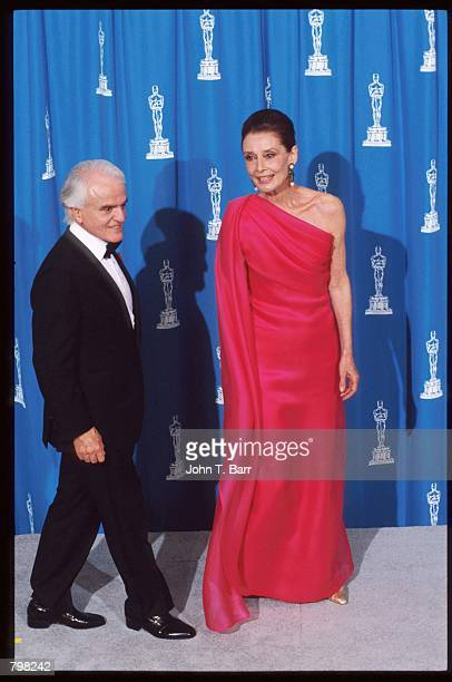 Chairman of the Motion Picture Association of America Jack Valenti stands with actress Audrey Hepburn at the 64th annual Academy Awards March 30 1992...
