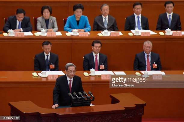 Chairman of the National Committee of the Chinese People's Political Consultative Conference Yu Zhengsheng delivers his report during the opening...