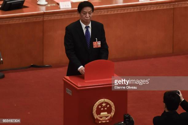 Chairman of the National People's Congress Li Zhanshu votes during the sixth plenary session of the National People's Congress at the Great Hall of...