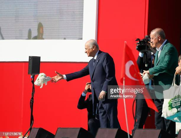 Chairman of the Nationalist Movement Party Devlet Bahceli greets the crowd during the AK Party MHP campaign rally ahead of March 31 local elections...