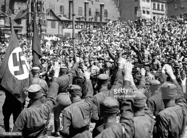 Chairman of the Nazi Party Adolf Hitler during the SA parade on the last day of the Nazi Party Conference in Nuremberg Germany 04 August 1929 To the...