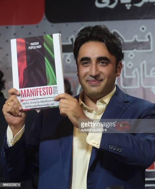 Chairman of the Pakistan Peoples Party Bilawal Bhutto Zardari displays a copy of his party manifesto for the forthcoming general election during a...