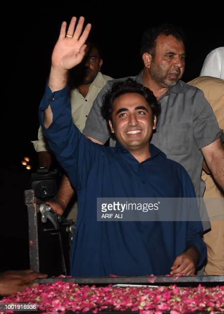 Chairman of the Pakistan Peoples Party Bilawal Bhutto Zardari waves from a car to supporters during an election campaign rally in Lahore on July 19...