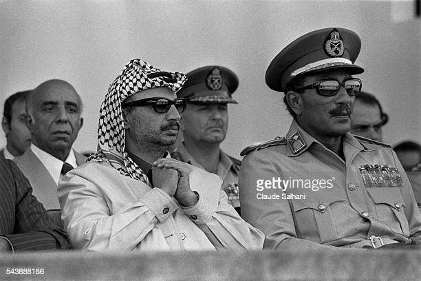 Chairman of the Palestine Liberation Organization Yasser Arafat and President of the Republic of Egypt Anwar Al Sadat attend a celebration in honor...