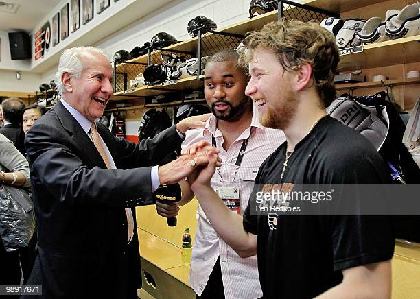 Chairman of the Philadelphia Flyers Ed Snider congratulates Claude Giroux after defeating the Boston Bruins 54 in overtime in Game Four of the...